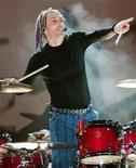 <p>Sevendust drummer Morgan Rose acknowledges the audience at the end of the group's set at the Mesa Amphitheatre in Mesa, Arizona, November 4, 2003. REUTERS/Ethan Miller</p>