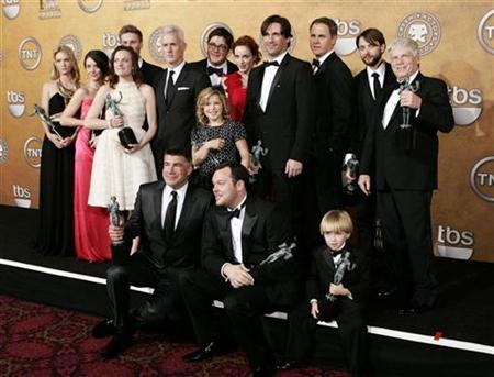 The cast of ''Mad Men '' pose after winning the award for Outstanding Performance by an Ensemble in a Drama Series at the 15th annual Screen Actors Guild Awards in Los Angeles January 25, 2009. REUTERS/Danny Moloshok