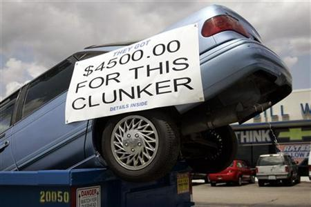 A vehicle sits in a dumpster on display in front of Bill Wink Chevrolet dealership to attract customers with the ''Cash For Clunkers' program in Dearborn, Michigan, August 6, 2009. REUTERS/Rebecca Cook