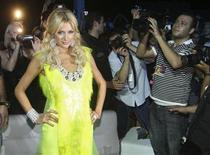 <p>U.S. socialite Paris Hilton poses at a party in downtown Beirut July 3, 2009. Picture taken July 3, 2009. REUTERS/Mohamed Azakir</p>