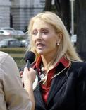 "<p>Kate Hanni, founder of FlyersRights.org, is interviewed during a ""Strand In"" event in Washington, in this September 19, 2007 handout photograph, released on August 17, 2009. REUTERS/FlyersRights.org/Handout</p>"