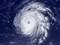 <p>Hurricane Bill is pictured moving through the Atlantic Ocean in a satellite image taken August 18, 2009. REUTERS/NOAA/Handout</p>