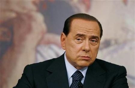 Italy's Prime Minister Silvio Berlusconi listens to a journalist's question as he addresses a news conference at Chigi Palace in Rome July 7, 2009. REUTERS/Alessia Pierdomenico
