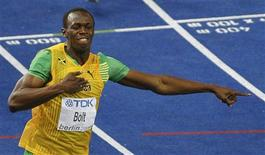 <p>Usain Bolt é ouro nos 200 metros e estabelece novo recorde mundial. REUTERS/Max Rossi</p>