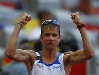 <p>Alex Schwazer si è ritirato dalla 50 km di marcia ai campionati mondiali di atletica leggera di Berlino dopo 1h e 50' circa, intorno a metà percorso. REUTERS/Mike Blake (CHINA)</p>