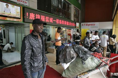 An African man stands near a shopping mall in the southern Chinese city of Guangzhou in Guangdong province March 27, 2009. REUTERS/James Pomfret