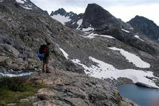 <p>A hiker makes his way without a trail across the Sierra High Route, a high-altitude journey through California's Sierra Nevada mountains July 31, 2009. REUTERS/Jon Hurdle</p>