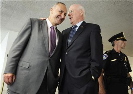 Senator Charles Schumer (D-NY) (L) smiles with Chairman Patrick Leahy (D-VT) (C) after the Judiciary Committee voted to send the U.S. Supreme Court nomination of Judge Sonia Sotomayor to the full senate for confirmation during a business meeting on Capitol Hill in Washington, July 28, 2009. REUTERS/Jonathan Ernst