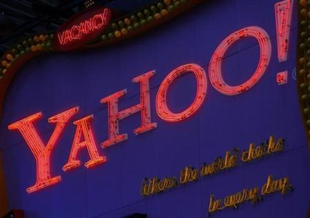 A Yahoo! sign is seen in New York's Times Square November 18, 2008. Yahoo announced late on Monday that Yang, whose leadership had come under growing criticism from shareholders after he failed to agree to a deal with Microsoft, would step down from his role as soon as the board finds a replacement. REUTERS/Brendan McDermid