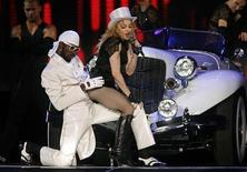 <p>U.S. pop singer Madonna performs during her Sticky and Sweet Tour concert in Budapest August 22, 2009. REUTERS/Karoly Arvai</p>