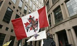 <p>Native flags fly during a protest and march in Vancouver, British Columbia June 29, 2007. REUTERS/Andy Clark</p>