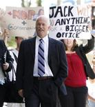 <p>Protestors follow New Democratic Party leader Jack Layton as he arrives at the Langevin Block to meet with Canada's Prime Minister Stephen Harper, in Ottawa August 25, 2009. REUTERS/Chris Wattie</p>