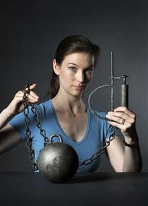 Museum of London archaeologist Kate Sumnall with the the 300 year-old iron ball and chain found on the banks of the river Thames by mudlarks. REUTERS/Museum of London/Handout