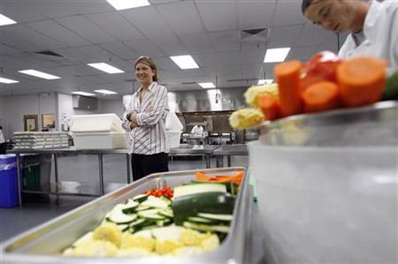 Kirsten Saenz Tobey, founder of Revolution Foods, poses in the company's kitchen in Los Angeles August 19, 2009. REUTERS/Mario Anzuoni