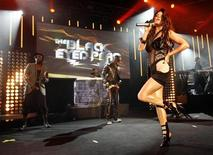 <p>Fergie (front) of the Black Eyed Peas performs during the Montreux Jazz Festival July 6, 2009. REUTERS/Denis Balibouse</p>