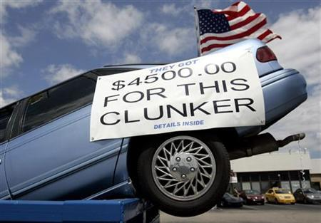 A vehicle sits in a dumpster on display in front of a Chevrolet dealership in Dearborn, Michigan, August 6, 2009. REUTERS/Rebecca Cook