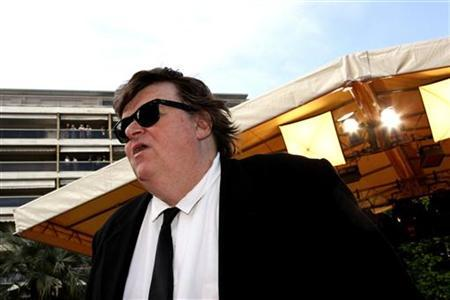 U.S. director Michael Moore arrives at the world premiere screening of ''Indiana Jones and the Kingdom of the Crystal Skull'' by U.S. director Steven Spielberg at the 61st Cannes Film Festival May 18, 2008. REUTERS/Jean-Paul Pelissier