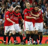 <p>Jogadores do Manchester United comemoram vitória por 2 a 1 contra Arsenal pelo Campeonato Inglês. REUTERS/Phil Noble</p>