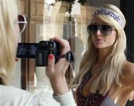 <p>U.S. socialite Paris Hilton is filmed by her personal photographer as she tours the Grand Hills hotel in Broumana, east of Beirut July 3, 2009. Picture taken July 3, 2009. REUTERS/ Sherine Raffoul</p>