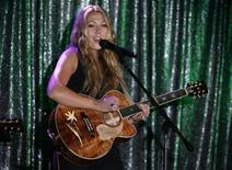 "<p>Singer and songwriter Colbie Caillat performs her song ""Bubbly"" which won Song of the Year at the 57th Annual BMI Pop Awards in Beverly Hills, California May 19, 2009. REUTERS/Fred Prouser</p>"