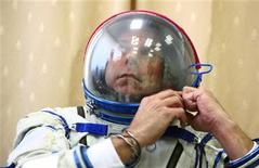 <p>Guy Laliberte prepares for exercises during a training session in the International Space Station (ISS) at the Star City space centre outside Moscow, August 25, 2009. REUTERS/Sergei Remezov</p>