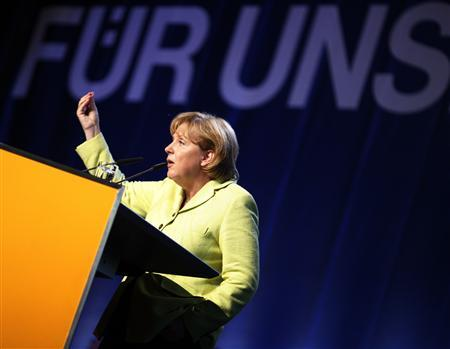 German Chancellor Angela Merkel of the Christian Democratic Union (CDU) delivers her speech during an election campaign rally in Neumuenster September 1, 2009. REUTERS/Christian Charisius