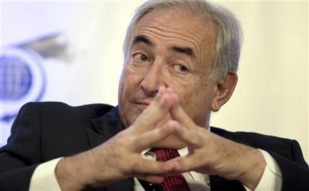 Dominique Strauss-Kahn, managing director, International Monetary Fund (IMF), is introduced at the International Economic Forum of the Americas conference in Montreal, June 8, 2009. REUTERS/Christinne Muschi