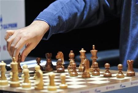 A player moves his bishops in Bonn October 27, 2008. REUTERS/Wolfgang Rattay