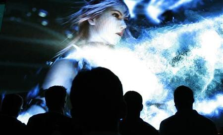 Visitors watch a trailer for Square Enix's Final Fantasy XIII video game during the Electronic Entertainment Expo (E3) in Los Angeles June 3, 2009. REUTERS/Mario Anzuoni