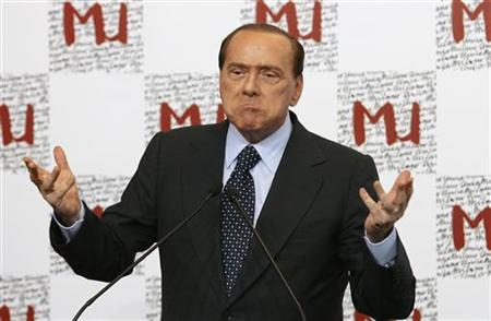 Italy's Prime Minister Silvio Berlusconi gestures as he speaks during a news conference at the Italian textile exposition ''Milano Unica'' in Milan September 8, 2009. REUTERS/Alessandro Garofalo (