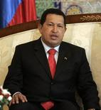 <p>Venezuela's President Hugo Chavez looks on after his arrival in Algiers September 2, 2009. REUTERS/Louafi Larbi</p>
