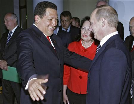 Russia's Prime Minister Vladimir Putin (R) says goodbye to Venezuela's President Hugo Chavez after talks in the Novo-Ogaryovo residence outside Moscow September 10, 2009. REUTERS/RIA Novosti/Pool/Alexei Druzhinin