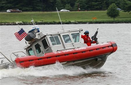 U.S. Coast Guard boats participate in a training exercise on the Potomac River in Washington, September 11, 2009, setting off a security scare as the United States marked the eighth anniversary of the September 11, 2001 attacks on New York, Washington and Pennsylvania. REUTERS/Yuri Gripas