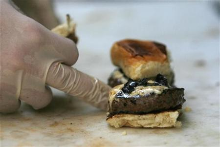 A Cougar burger is prepared in the Baby's Badass Burgers truck in Hollywood, California August 27, 2009. REUTERS/Mario Anzuoni