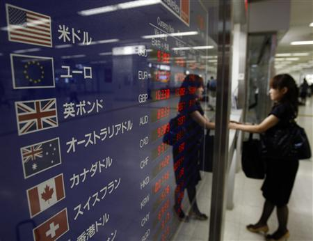 A woman exchanges money at a money exchange at Haneda airport in Tokyo September 15, 2009. REUTERS/Yuriko Nakao