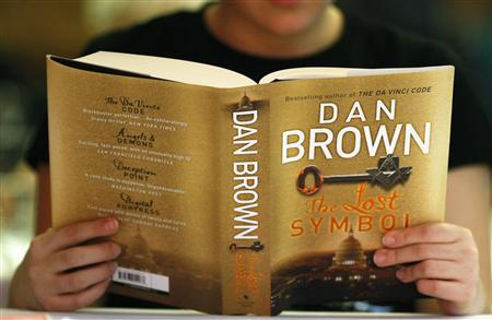 A woman reads a copy of the newly released book ''The Lost Symbol'' by Dan Brown, at a speed reading book launch event in Sydney September 15, 2009. REUTERS/Tim Wimborne