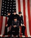 <p>The Beatles, (L-R) Ringo Starr, John Lennon, George Harrison and Paul McCartney (seated), in an undated publicity photo. REUTERS/File</p>