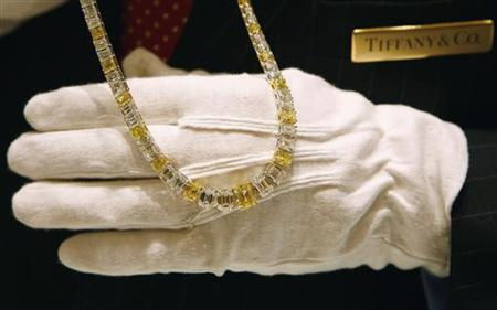 Tiffany and Co. salesman Peter Englehart displays a yellow emerald-cut diamond necklace selling for $1.2 million in their newest Tiffany and Co. store on Wall Street in New York City October 10, 2007. REUTERS/Mike Segar