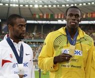 <p>O velocista norta-americano Tyson Gay levou a prata em Berlim, quando o jamaicano Usain Bolt quebrou o recorde dos 100 metros. REUTERS/Wolfgang Rattay</p>