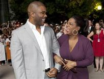 "<p>Oprah Winfrey and Tyler Perry arrive at the ""Precious"" film screening during the 34th Toronto International Film Festival, September 13, 2009. REUTERS/Mark Blinch</p>"
