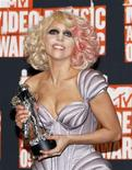 <p>Lady Gaga stands backstage with the best new artist award at the 2009 MTV Video Music Awards in New York, September 13, 2009. REUTERS/Lucas Jackson</p>