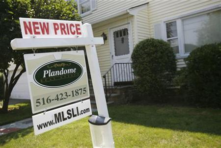 A listing for a new price on a home for sale is seen on a sign in Manhasset, New York August 18, 2009. REUTERS/Shannon Stapleton