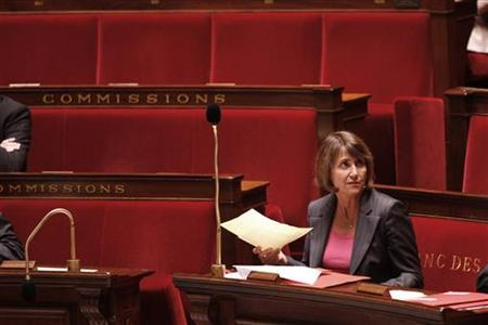 France's Culture Minister Christine Albanel sits in the minister's benches at the National Assembly in Paris May 12, 2009, during the vote on a law to prohibit internet piracy. REUTERS/Charles Platiau