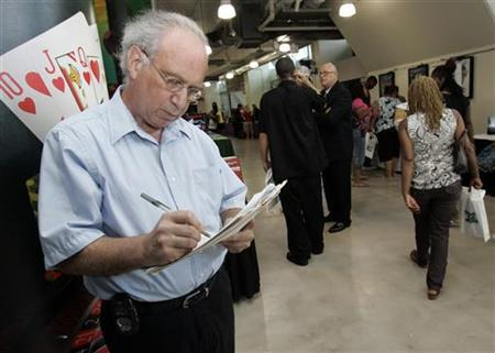 Eugene Salvino, 57, fills out a job application at a job fair in Pittsburgh, Pennsylvania, on August 4, 2009. Salvino's job of 37 years was eliminated a year and a half ago and he's been unable to find a position. REUTERS/Jason Cohn