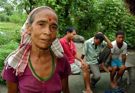 Dimbeswari Bhattarai (front), a witch doctor, or ojha, speaks during an interview with Reuters in Uttarkuchi village in India's northeastern state of Assam September 7, 2006. Police say that around 300 people have been killed in the state in the five years from 2001 for allegedly practising witchcraft. REUTERS/Utpal Baruah