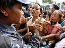 <p>Maoist activists and supporters shout at police during a protest in Kathmandu, September 24, 2009. REUTERS/Deepa Shrestha</p>