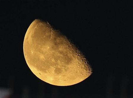 The moon rises over Cairo in this September 10, 2009 file photo. REUTERS/Amr Abdallah Dalsh