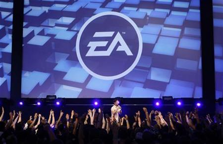 Visitors attend a show by Electronic Arts (EA) at the Gamescom 2009 fair in Cologne August 22, 2009. REUTERS/Ina FAssbender