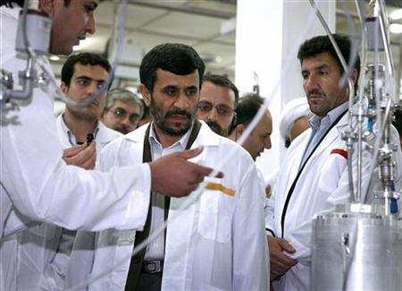 Iranian President Mahmoud Ahmadinejad (C) visits the Natanz nuclear enrichment facility, 350 km (217 miles) south of Tehran, April 8, 2008.REUTERS/Presidential official website/Handout