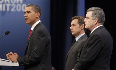 U.S. President Barack Obama (L) holds a news conference with France's President Nicholas Sarkozy (C) and Britain's Prime Minister Gordon Brown at the G20 Summit at the Pittsburgh Convention Center in Pittsburgh, Pennsylvania, September 25, 2009. REUTERS/Jim Young